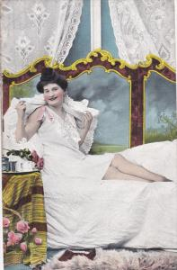 Woman sitting up in bed, wicker basket of roses, 00-10s