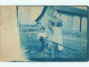 Pre-1920 rppc WOMAN CHOPS WOOD Postmarked Toledo Ohio OH i7191