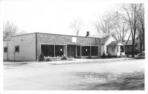 Sebewaing Michigan~Store Front Building~Houses Down Street~1940s Car~RPPC