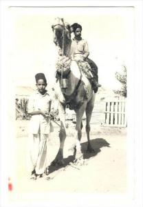 RP  Man & boy with camel, Karachi , Pakistan, PU-1951