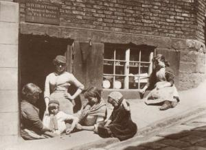 Whitby Grocers with Children Playing Ball & Stone Street Game Yorkshire Postcard