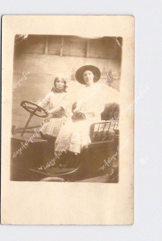 RPPC REAL PHOTO POSTCARD SOUVENIR PICTURE ANTIQUE CAR WOMAN AND GIRL DRIVING SOU
