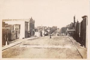 Radcliffe IA~Main Street North~Rugs Books~Lunch Room~Ice Cream Parlor~c1912 RPPC