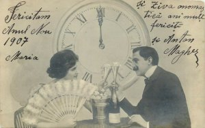 Fancy couple New Year champagne cheers clock lady fan 1907 postcard
