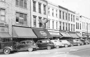 Keokuk IA~Main Street~Baker's Rexall~Hausch Bakery~Flynn & Boyle~Cars~1930s RPPC