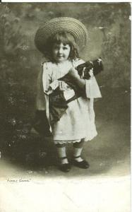 Family Cares, little girl standing with doll, early 1900s
