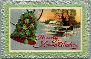 1910 CHRISTMAS Postcard Hearty Xmas Wishes Holly Bell / Winter Bridge Scene