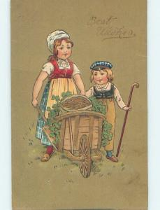 Pre-Linen SHAMROCKS AND GOLD COINS BEING MOVED ON WOODEN WHEELBARROW HL5317