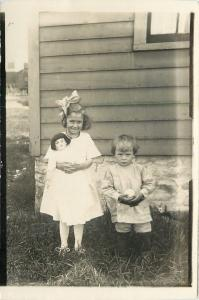 Little Girl Holds Black-Haired Dolly~Sibling Siddell Has Baseball RPPC 1914