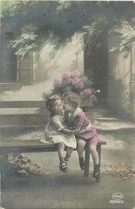 Lovely children couple kiss early tinted postcard