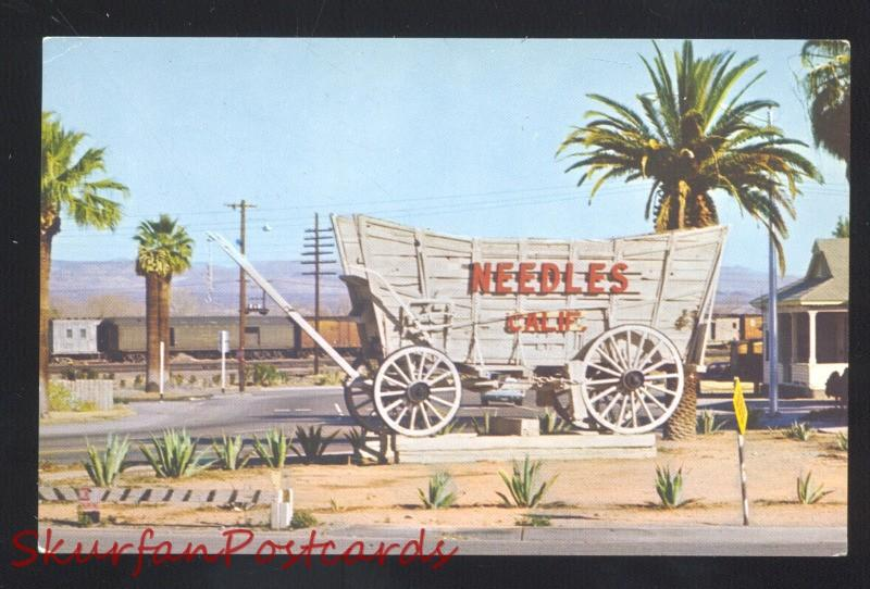 NEEDLES CALIFORNIA ROUTE 66 COVERED WAGON SIGN RAILROAD VINTAGE POSTCARD