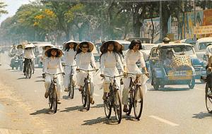 Vietnam, Viet Nam High School Girls Cycling their way to class, Ao Dai  Girls...