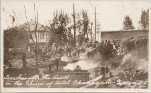 Hotel Okanagan Vernon BC 'Searching for Dead in the Ruins' RPPC Postcard E55