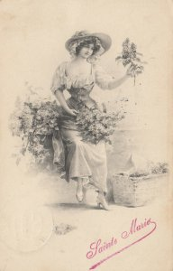 AS; M.M. VIENNE; Young woman admiring flowers, 1900-10s