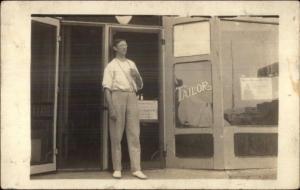 Tailor Shop - Tailor w/ Measuring Tape Eyeglasses Storefront c1910 RPPC