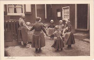 MARKEN, Dutch Girls holding hands in a circle, North Holland, Netherlands, 10...
