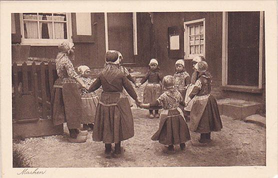 MARKEN, Dutch Girls holding hands in a circle, North Holland, Netherlands, 10...