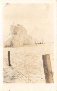 Ocheyedan IA Train w/Bucker? Wedge? Snow Plow Beyond Barb-Wired Fence~RPPC c1912