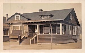 MAN & 2 WOMEN ON FRONT PORCH OF RANCH STYLE HOUSE-REAL PHOTO POSTCARD 1910s