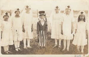 RP: Child Uncle Sam holding an American Flag & Child Red Cross Nurses , 00-10s