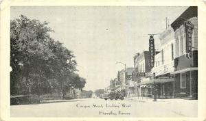 Hiawatha Kansas~Oregon Street West~Carpenter Drugs~McDonalds Store~Bank~1940 B&W