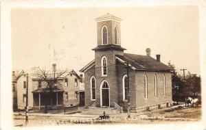 Elkader Iowa~German Ev Friedens Church~Horse & Buggy in Street~Houses~1920 RPPC