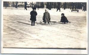Vintage RPPC Real Photo Postcard Frozen Pond Scene Children w/ Sleds c1910s