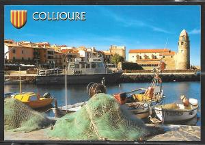 Collioure, France, fishing boat, nets, writing on back