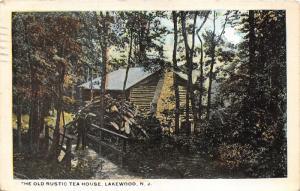 Lakewood New Jersey~Old Rustic Tea House~Man on Bridge~Wood Pile~1923 Postcard