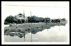 4084 - LA SARRE Quebec 1940s Road View. Real Photo Postcard