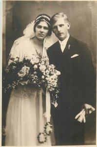 Groom & bride early wedding photo postcard