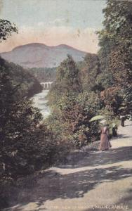 Woman Walking With An Umbrella, Distant View Of Viaduct, Killiecrankie, Scotl...