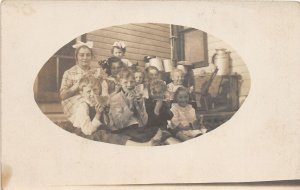F47/ Interesting Real Photo RPPC Postcard Eating Watermelon c1910 Kids Porch 5