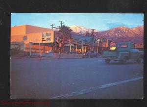 YUCAIPA CALIFORNIA DOWNTOWN STREET SCENE AT NIGHT OLD CARS VINTAGE POSTCARD