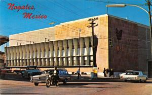 Nogales Mexico~Government Hospital~Man on Motorcycle Passes Station Wagon~1971
