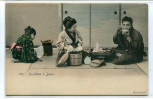 Japanese Woman Man Lunchtime in Japan 1905c hand colored postcard