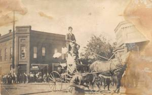 F25/ Interesting RPPC Photo Postcard c1910 Parade Man High Chair Wagon Odd 15