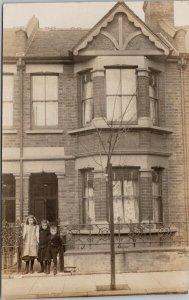 Portrait of Three Children Girls Boy House Home Unused Real Photo Postcard E88