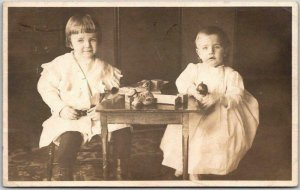 Vintage RPPC Studio Real Photo Postcard Two Little Girls at Table w/ Toys - 1911