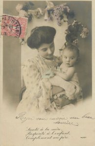 sitting mother with little baby fancy coiffure floral design Post card