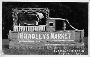 H30/ Princeton Illinois RPPC Postcard c20s Parade Float Bradley's Market Cow