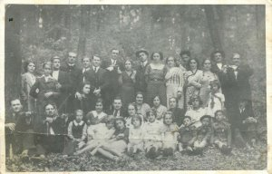 Postcard elegant gentlemen and women forest outing group photo