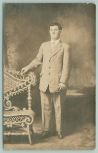 RPPC From J.P to Elsie~Gentlemen in Light Colored Suit~Fancy Wicker Settee 1910