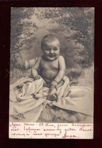 017889 Happy Boy on Fur. Vintage Real Photo PC
