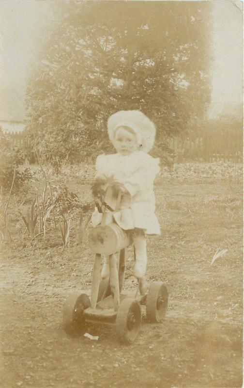 Lil Girl~White Bonnet~Dress~Rides Hand Made Wheeled Hobby Horse~1910 RPPC