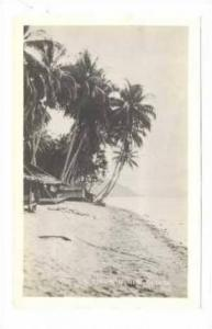 RP New Guinea, WWII, Grass roof huts along beach