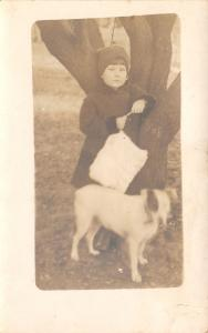 Little Girl by Tree w/A Furry Purse & Her Bull Terrier w/A Black Eye RPPC c1910