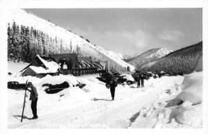 Stevens Pass Washington~Winter Time~Skiers on Road~Snow Buried Cars~1940s RPPC