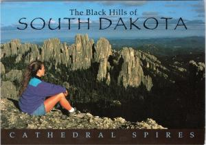 Female hiker viewing the Cathedral Spires of the Black Hills South Dakota