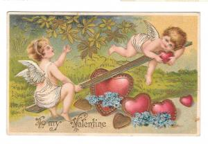Cupids Cherubs Hearts on See Saw Teeter Totter Embossed Gilt Valentine Postcard
